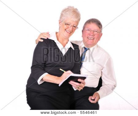 Mature Businessman With Secretary On His Knee