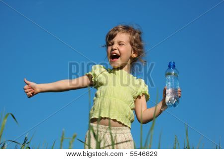 Screaming Girl In Grass With Plastic Bottle With Water