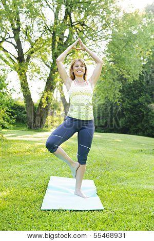 Woman In Yoga Tree Pose