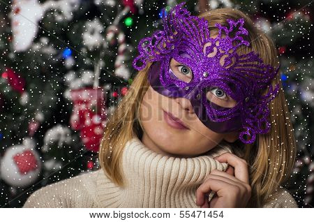 Beautiful young woman in mask