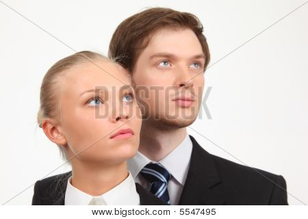 Young Business Woman And Businessman Look Upward