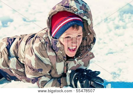 Cute Boy Eating The Snow