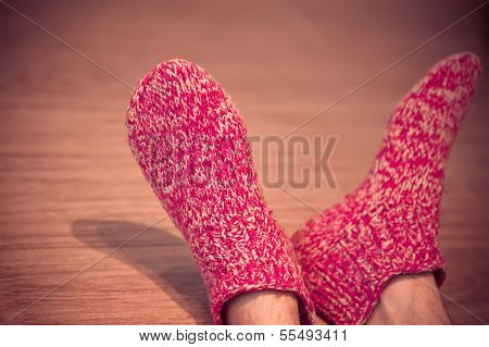 Man Legs In Red Wool Socks Male Knitted Clothes Winter Handmade Accessories Home Comfort Concept On