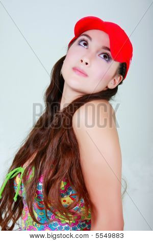 Young Girl In Red Cap Looking Up