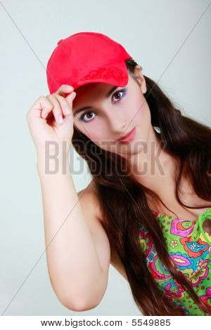 Young Girl In Red Cap