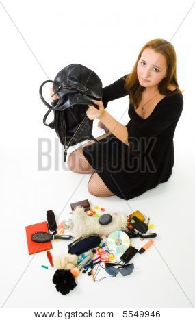 Woman Looking In Her Hand Bag