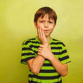 stock photo of toothache  - young boy child toothache pain in mouth - JPG