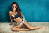 foto of short legs  - Summer photo of beautiful brunette woman posing in sunglasses and wearing swimsuit - JPG