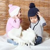 image of knitwear  - Little kids dressed in warm knitwear for cold weather - JPG