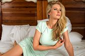 image of tight dress  - Beautiful tall blonde in a tight green dress - JPG