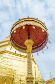 stock photo of cho-cho  - Golden umbrella at Wat Phra That Cho Hae  - JPG