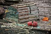 stock photo of lobster  - A wooden lobster trap with buoys and rope on a Newfoundland - JPG