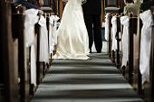 foto of pews  - Bride and groom getting married in church view from aisle - JPG