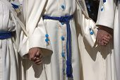 picture of tunic  - penitents with white tunics gathers of the hand during a procession of Holy Week Spain - JPG