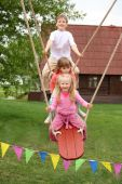 Three Children On Teetering-board
