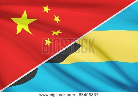 Series Of Ruffled Flags. China And Commonwealth Of The Bahamas.