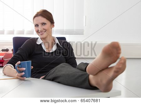 Young Woman Makes A Coffee Break