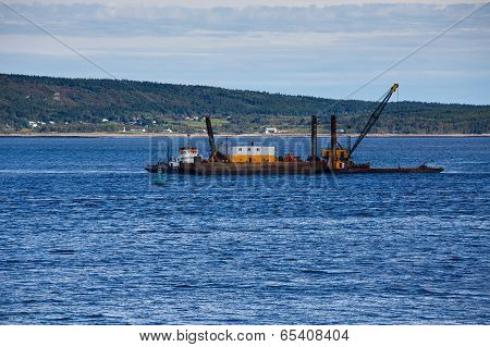 Working Barge On Canadian Coast