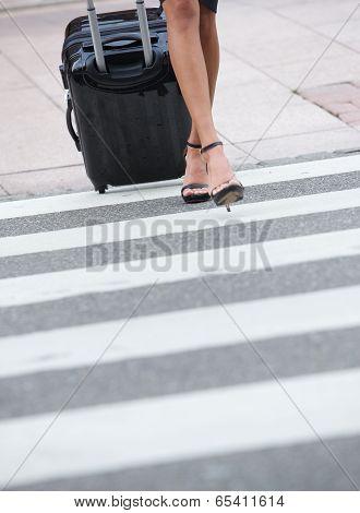 Businesswoman Crossing Zebra Crossing