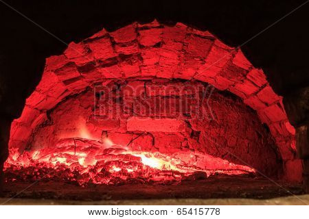 Burning wood in the hearth furnace
