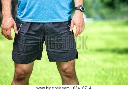 Closeup Of A Male Runner Standing - Space For Text.