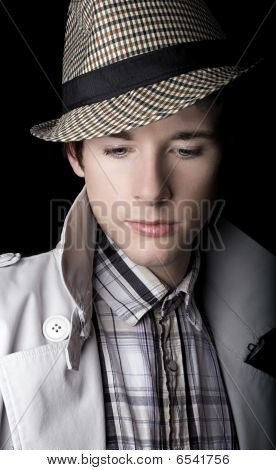 Portrait of a young man in a trilby hat