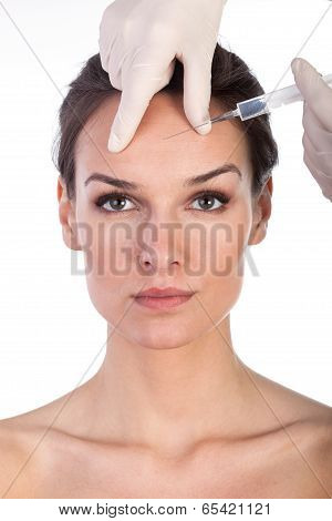 Giving Botox Injection In Female Skin