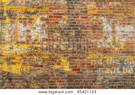 Faded Advertisement On A Brick Wall