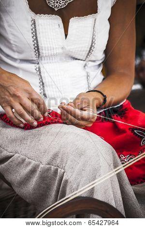 distaff, woman spinning yarn on an old spinning wheel