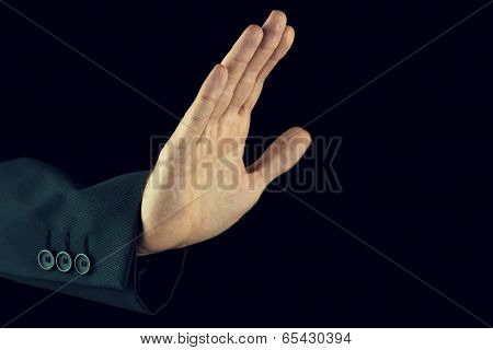 Man Raising His Hand In A Stop Gesture