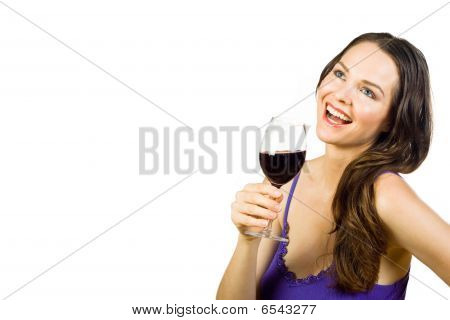 Beautiful Young Woman Laughing And Holding A Glass Of Red Wine