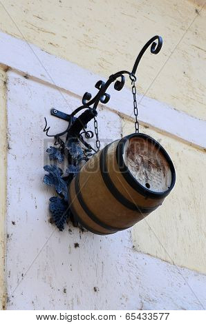 hanging wine barrel on ancient building