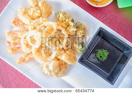 Vegetable Tempura And Chopsticks On A White Plate.
