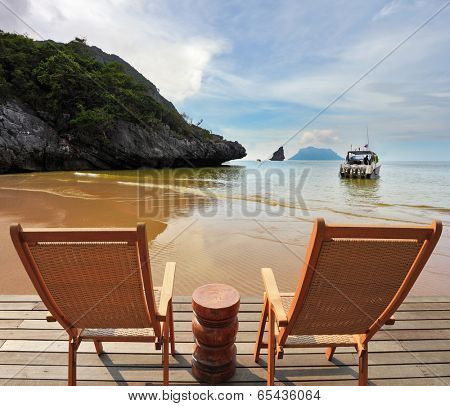 Charming lookout for two. Two convenient comfortable guest sun loungers and a bedside table are worth on a wooden platform. Hence it is convenient to admire the sandy sea beach