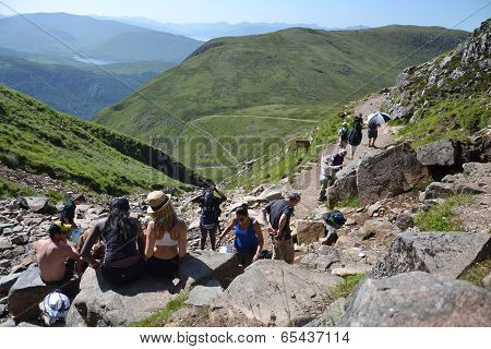 People hiking on path to the Ben Nevis summit - the highest mountain in the United Kingdom