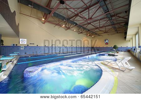 MOSCOW, RUSSIA - MAY 8, 2014: Pool of fitness center Gold Gym with traineger equipments. In Russia, Gold Gym opened in 1996.