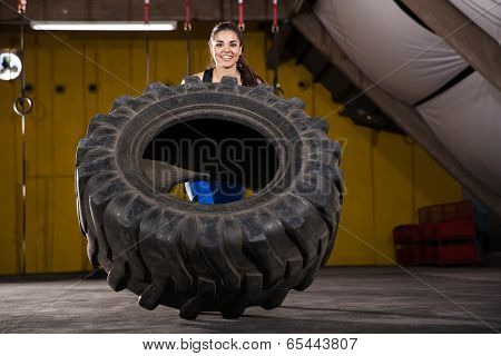 Happy Girl Flipping A Tire