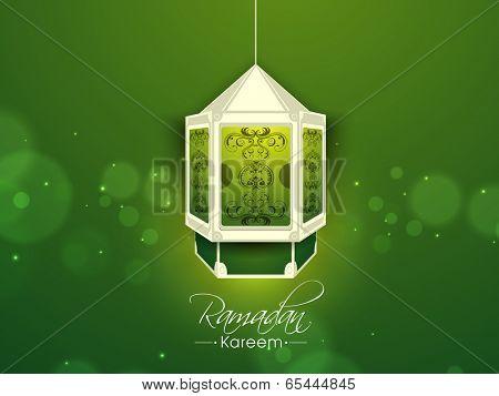 Intricate arabic lantern or lamp on shiny green background for holy month of muslim community Ramadan Kareem, beautiful greeting card or invitation card design.