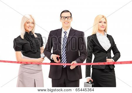 Business people cutting a red tape isolated on white background