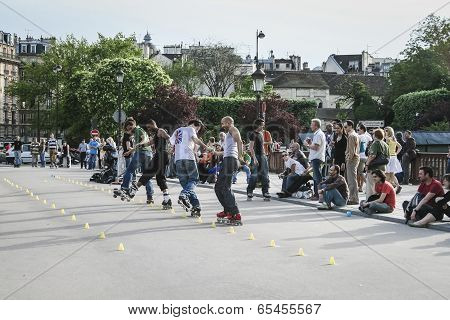 In-line Skaters Performing For A Crowd, Paris, France