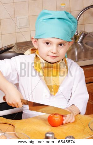 Little Cook With Knife And Tomato
