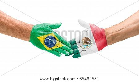 Handshake Brazil and Mexico on a white background