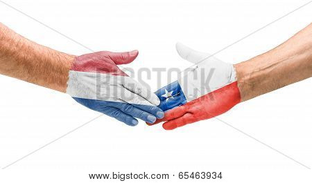 Handshake Netherlands and Chile on a white background