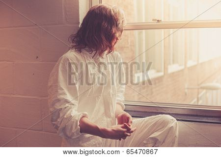 Woman In Boiler Suit By Window
