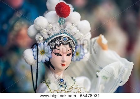 BEIJING, CHINA - DEC 16: Souvenir store's display window, December 16, 2013 in Beijing, China. Chinese classical character model is tourist souvenirs