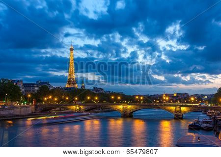 Paris - May 9: Cityscape Of Paris With Eiffel Tower (tour Eiffel) And Pont Des Invalides At Night Il