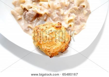 A Biscuit As A Side Dish Of A Gravy Pasta Dinner