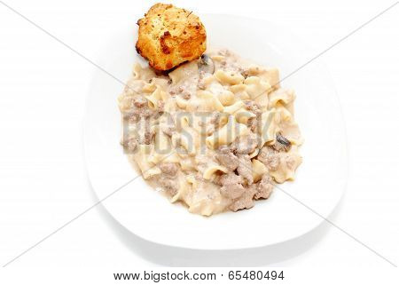 Beef Stroganoff Served With A Golden Biscuit