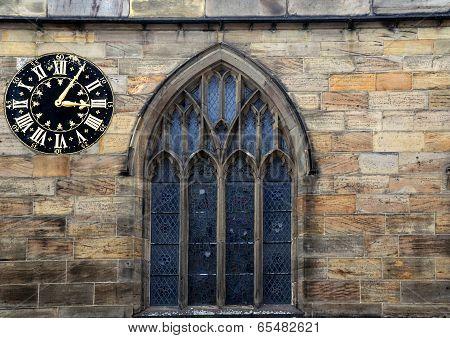 Old Window And Clock. York. Uk
