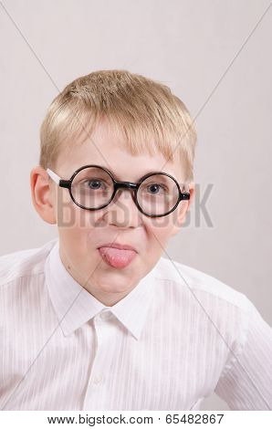 Teenager In Glasses Showing Tongue